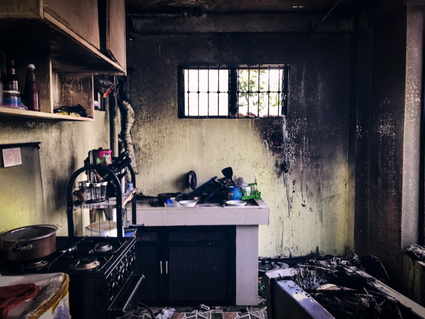 Interior of a kitchen with fire damage